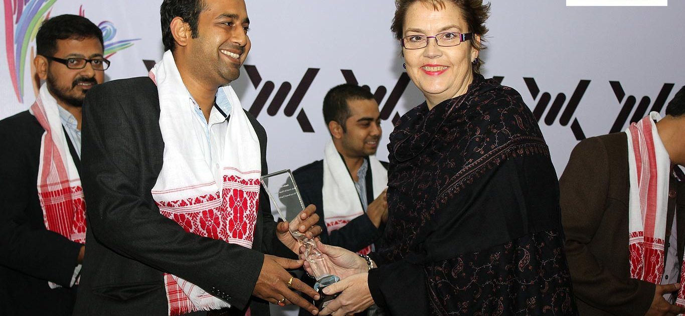 Impulse ModeAmit Patro, Editor of Sikkim Express receives the Impulse Model Media Award, for Change Makers 2013, from Ms. Cristina Albertin, Representative of the UNODC Regional Office for South Asial | The role of the Press against Human Trafficking
